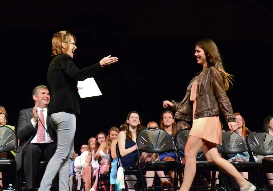Dr. Lisa Arbus presents Kala Berg with the Carl Howard Memorial Scholarship Award, at the New Canaan High School Recognition Assembly on May 30, 2014. Photo: Jeanna Petersen Shepard, Freelance Photo / New Canaan News freelance