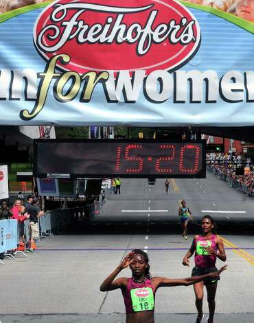 Lucy Kabuu of Kenya wins the Freihofer's 36th  Run for Women on Saturday May 31, 2014 in Albany, N.Y. (Michael P. Farrell/Times Union) Photo: Michael P. Farrell / 00027076A