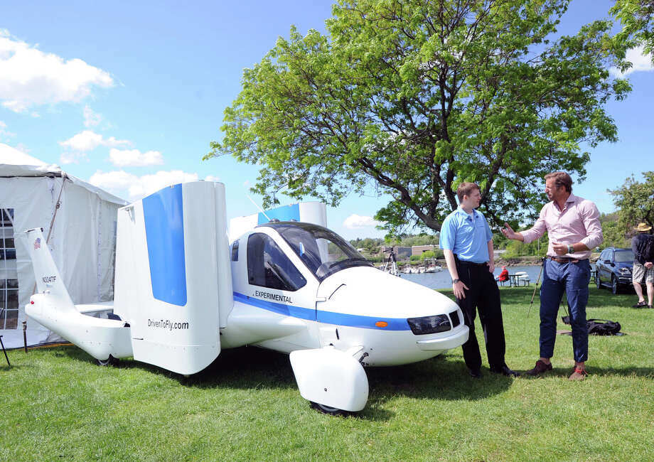 "The Transition ""a street-legal airplane that converts between flying and driving modes in less than one minute,"" according to Alex Min of Terrafugia  Company that makes the craft, was on display as part of the Greenwich Concours d'Elegance at Roger Sherman Baldwin Park in Greenwich, Saturday, May 31, 2014. Photo: Bob Luckey / Greenwich Time"