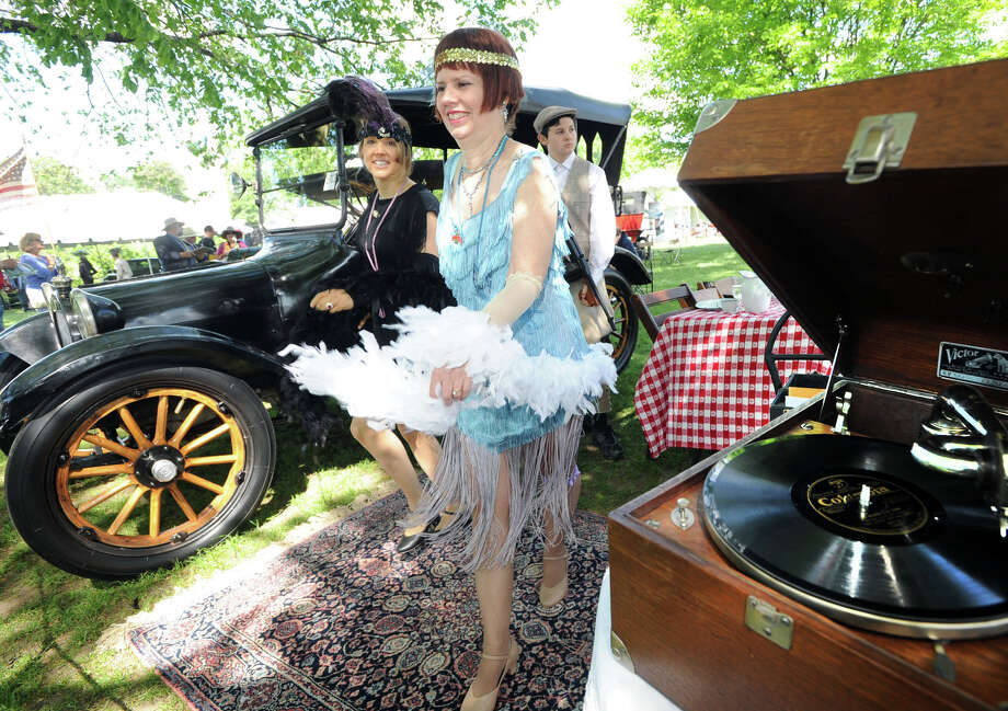 Foreground, Gwen Ackley of Fairfield is dressed in a 1920s outfit while dancing near her 1915 Dodge Brothers Five-Passenger Touring car during the Greenwich Concours d'Elegance at Roger Sherman Baldwin Park in Greenwich, Saturday, May 31, 2014. Photo: Bob Luckey / Greenwich Time