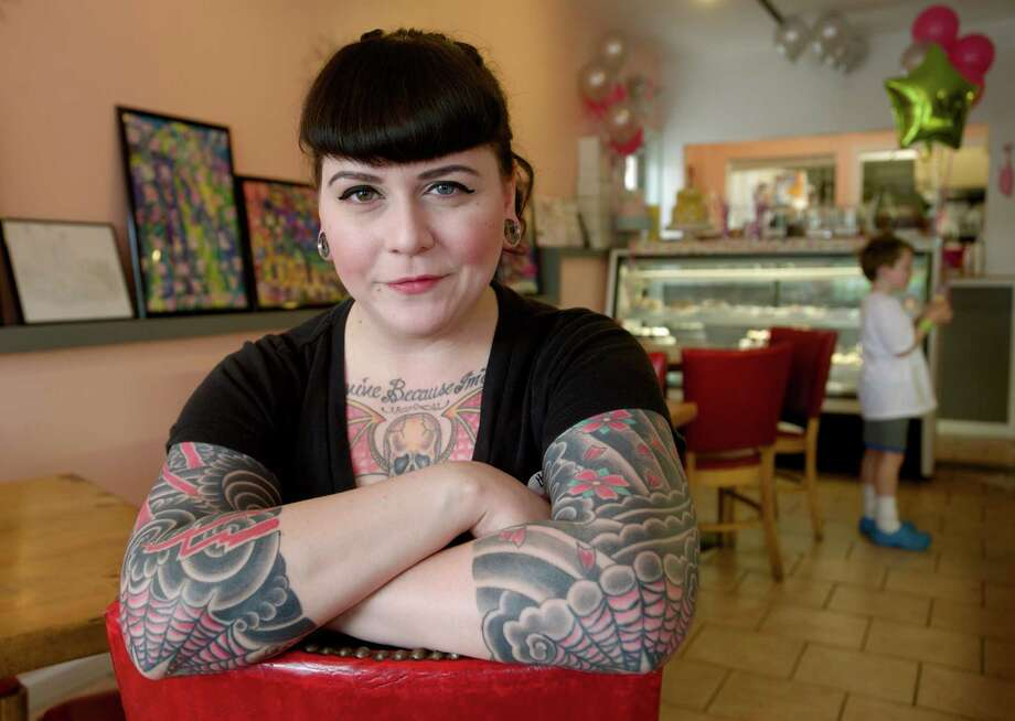 Jolene Sallisky, 35, of Danbury,  the owner of The Sweet Spot, in New Milford, Conn, a combination ice cream store and bakery, sits in her Railroad Street store on Saturday, May 31, 2014. The store is celebrating it's fifth anniversary. Photo: H John Voorhees III / The News-Times Freelance