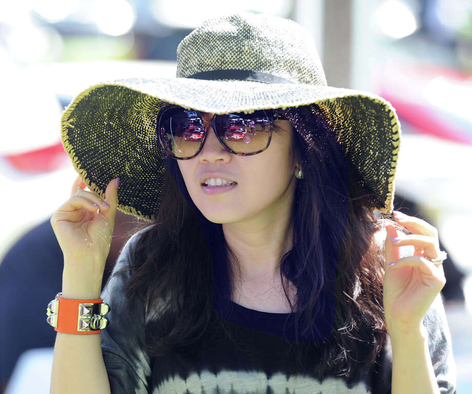Miya Liu of New York City wore a floppy and sunglasses to the Greenwich Concours d'Elegance at Roger Sherman Baldwin Park in Greenwich, Saturday, May 31, 2014. Photo: Bob Luckey / Greenwich Time
