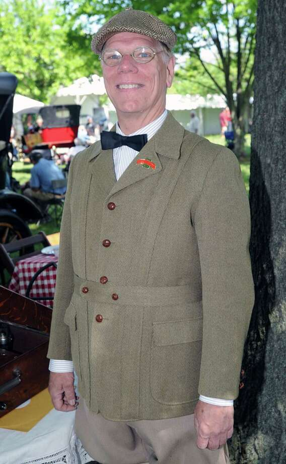 Parker Ackley of Fairfield came dressed in a Roaring 20's outfit to match his 1915 Dodge Brothers Touring car during the Greenwich Concours d'Elegance at Roger Sherman Baldwin Park in Greenwich, Saturday, May 31, 2014. Photo: Bob Luckey / Greenwich Time