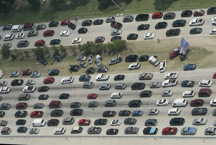 Vehicles, some overheated, broken down or out of gas, sit in the median of Interstate 45 in The Woodlands in September 2005 during Hurricane Rita evacuation. After Rita, a contra-flow system for regional interstate highways was put in place to ease congestion during storm evacuations. Photo: RALPH LAUER, MBR / FORT WORTH STAR-TELEGRAM