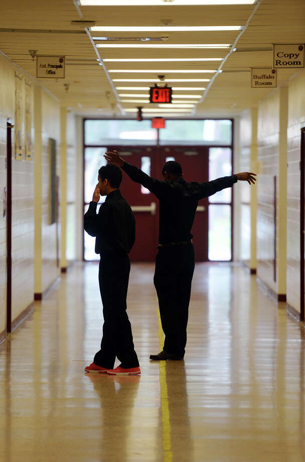 Dwayne Moore, 17, and Earl Sigee, 17, members of the God's Movement mime troupe, practice inside Smith Magnet Middle School on Saturday. The Super STAAR North Beaumont Block Party was held at Smith Magnet Middle School on Saturday. Admission was free to the event, which included food, vendors, live dance performances, and a health fair where attendees could have their blood pressure checked and get vaccinations. Principal Wilbert Andrews said attendance during over the last two years had been between 1100-1200, but they hoped to increase those numbers by hosting the party later in the day. Photo taken Saturday 5/31/14 Jake Daniels/@JakeD_in_SETX Photo: Jake Daniels / ©2014 The Beaumont Enterprise/Jake Daniels