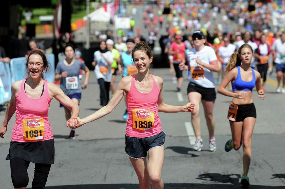 Runners approach the finish line during the Freihofer's 36th Run for Women on Saturday, May 31, 2014, in Albany, N.Y.  (Cindy Schultz / Times Union) Photo: Cindy Schultz / 00027076A