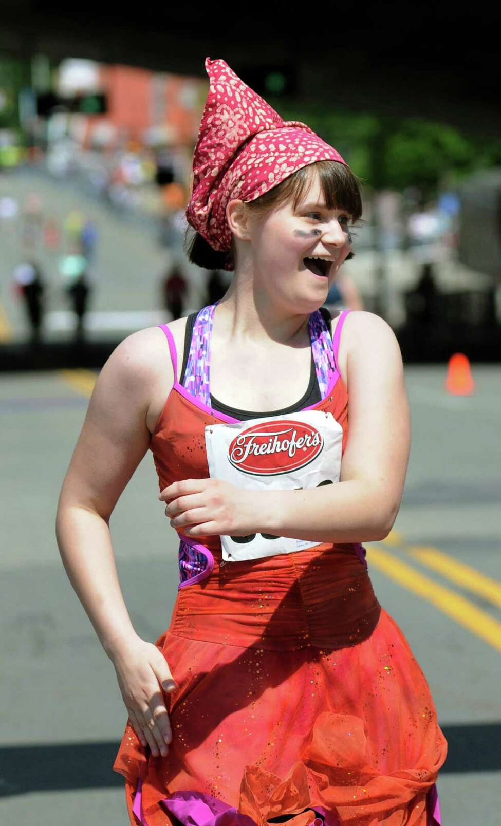Annika Rosenswig, 12, of Albany wears a festive outfit as she runs during the Freihofer's 36th Run for Women on Saturday, May 31, 2014, in Albany, N.Y. (Cindy Schultz / Times Union)