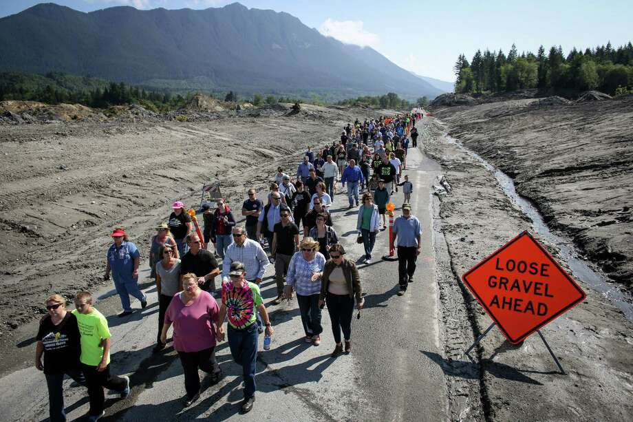 Hundreds of Oso, Darrington and Arlington residents walk on state Route 530 before the highway was reopened to cars. A little more than two months after the Oso mudslide destroyed a neighborhood and killed 43 people, the highway through the heart of the slide reopened to vehicle traffic. Motorists must follow a pilot car that directs a single direction at a time. Photographed on Saturday, May 31, 2014. Photo: JOSHUA TRUJILLO, SEATTLEPI.COM / SEATTLEPI.COM