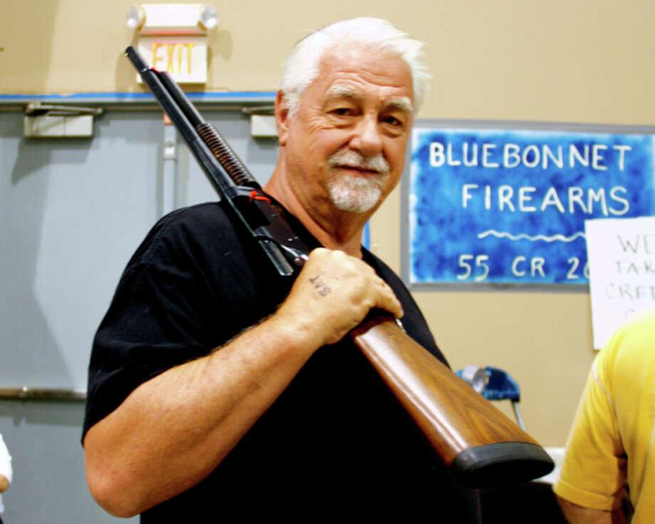 Gun enthusiasts packed Freeman Coliseum for the San Antonio Gun Show by Premier Gun Shows. Photo: 0320412472, By DeAnne Cuellar, For MySA.com