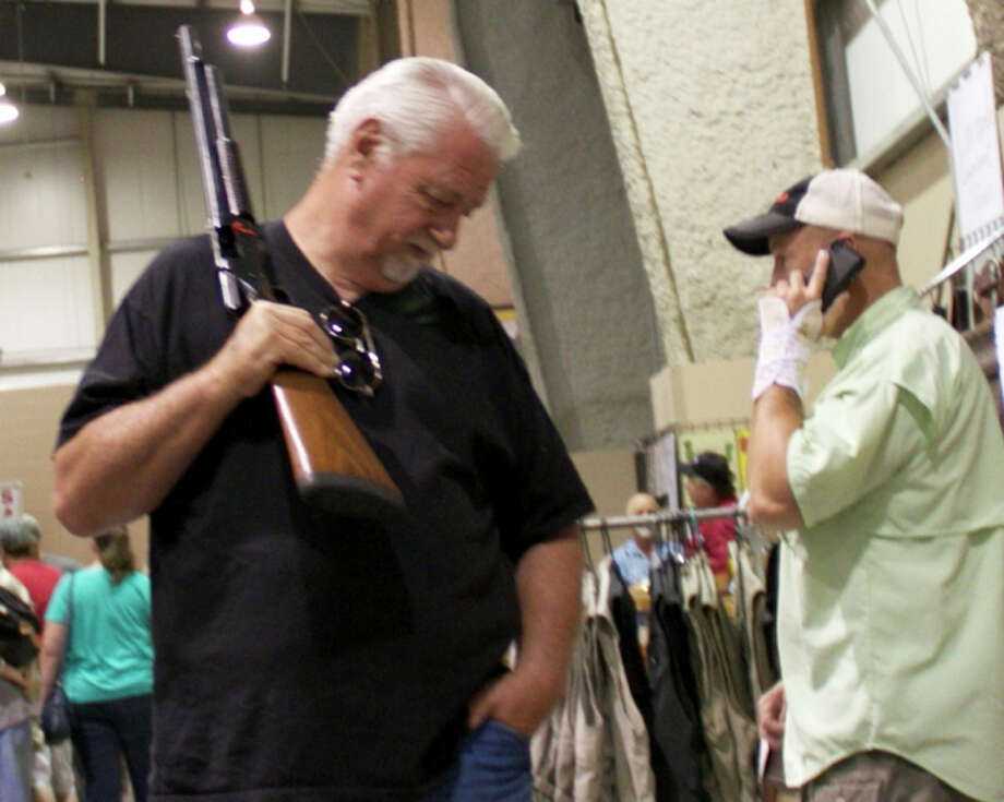 Gun enthusiasts packed Freeman Coliseum for the San Antonio Gun Show by Premier Gun Shows. Photo: 0320412472, By DeAnne Cuellar, For MySA.com