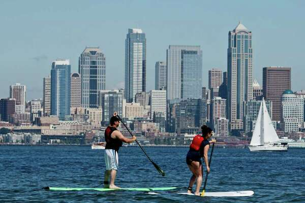 Stand-up paddleboarding is a middle ground between surfing and boating. You balance on a board while paddling over calm waters. It's very easy to get into and provides a great workout.