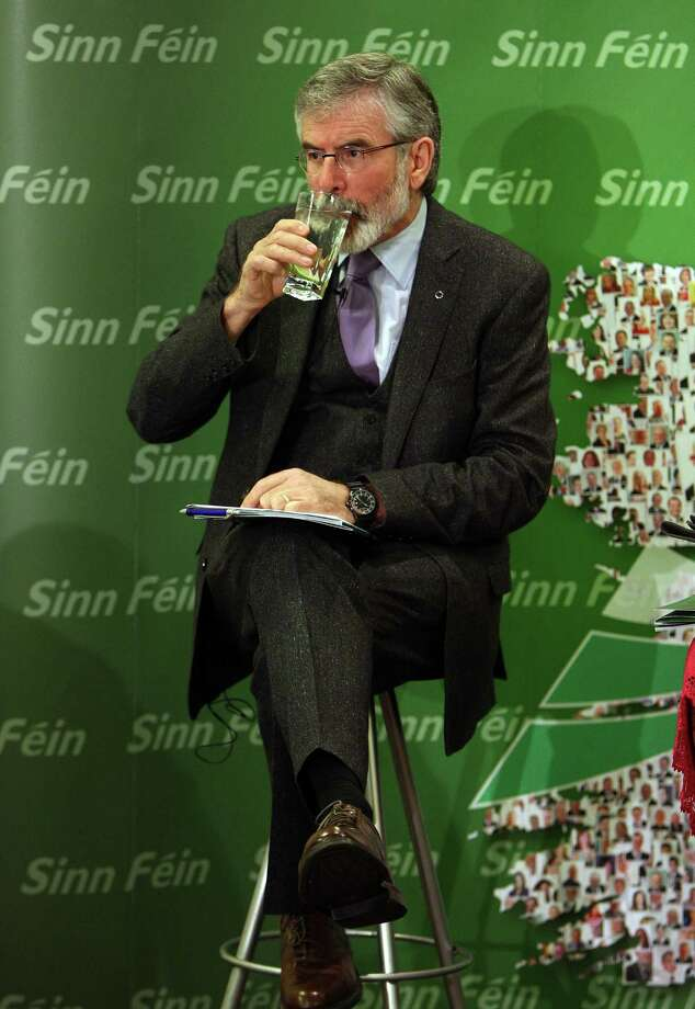 Sinn Fein President Gerry Adams takes a drink during a break at their European Election manifesto launch in Belfast, Northern Ireland on May 12, 2014. Elections for a new European Parliament take place over four days from May 22 across the 28 countries of the European Union, with 751 seats at stake. Voting in Northern Ireland takes place on the Thursday May 24, 2014. AFP PHOTO/PAUL FAITHPAUL FAITH/AFP/Getty Images Photo: PAUL FAITH / AFP
