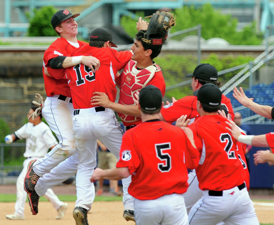 Fairfield Warde celebrates its win over Trumbull, during FCIAC Championship baseball action at the Ballpark at Harbor Yard in Bridgeport, Conn. on Saturday May 31, 2014. Photo: Christian Abraham / Connecticut Post