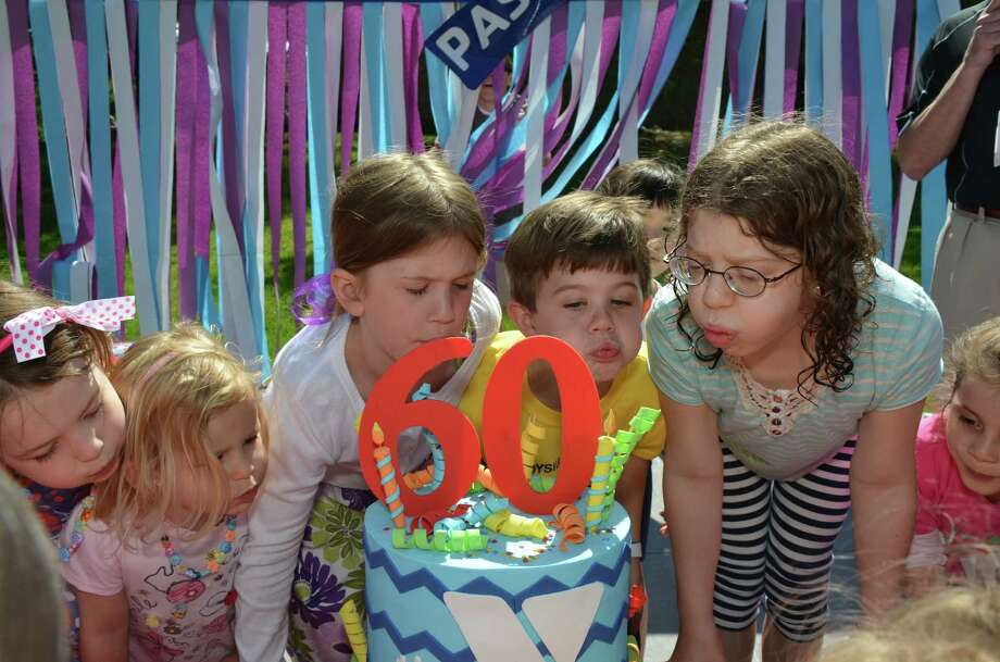 Olivia and Charlotte Edwards, Natasha and Jack Lilly, and Emma Youngman, blow out the candles at the YMCA's 60th Birthday Bash, in New Canaan, Connecticut, on Saturday, May 31, 2014. Photo: Jeanna Petersen Shepard, Freelance Photo / New Canaan News freelance