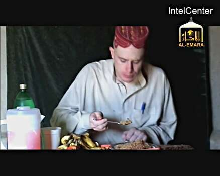 "On December 25, 2009, the Taliban's al-Emara Jihadi Studio, part of the Commission of Cultural Affairs Audio and Video Department of the Islamic Emirate of Afghanistan, released a 36'27"" hostage video of US soldier Bowe Bergdahl. The video has a production date of Dec. 2009. Initial analysis indicates the hostage appearing in the video is Bowe Bergdahl. He is shown in this image eating in local dress. He identifies himself as Bowe Bergdahl in the video and provides identifying details about his background and identity. In a statement released May 31, 2014, US Secreatry of Defense Chuck Hagel said, ""A few hours ago, the family of Sgt. Bowe Bergdahl was informed by President Obama that their long wait for his return will soon be over.  Sgt. Bergdahl is now under the care of the U.S. military after being handed over by his captors in Afghanistan."" == RESTRICTED TO EDITORIAL USE / MANDATORY CREDIT: ""AFP PHOTO HANDOUT-INTELCENTER""/ NO MARKETING - NO ADVERTISING CAMPAIGNS  NO A LA CARTE SALES / DISTRIBUTED AS A SERVICE TO CLIENTS = NO OBSCURING OR CROPPING OUT INTELCENTER LOGO NOT PERMITTED == -/AFP/Getty Images Photo: -, AFP/Getty Images / AFP"