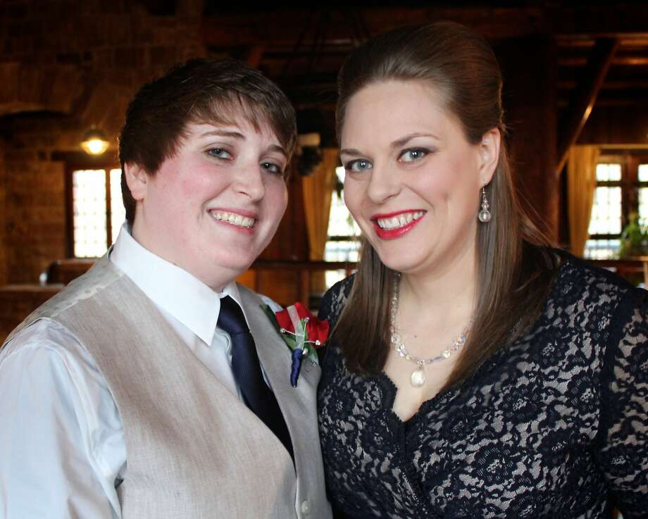Chelsea Baker (left) and Sabra Blumhorst, who exchanged vows last year, plan to get their marriage license now that Illinois has recognized same-sex marriage. Photo: Jen Haselhorst, Associated Press