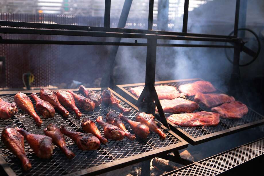 Turkey legs and ribs smoke at Big Bear BBQ at the 2014 Bottlerock Napa Valley music, food and wine festival on Saturday, May 31, 2014 in Napa, Calif. Photo: Kevin N. Hume, The Chronicle