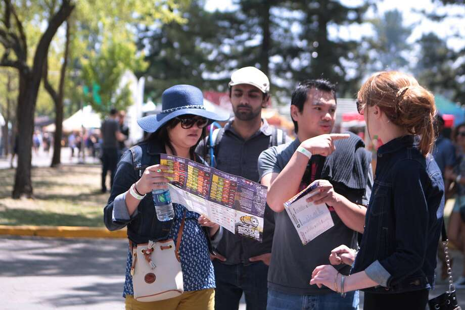 Concert goers try to plan their day at the 2014 Bottlerock Napa Valley music, food and wine festival on Saturday, May 31, 2014 in Napa, Calif. Photo: Kevin N. Hume, The Chronicle