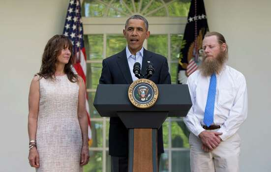 President Barack Obama speaks with Jani Bergdahl, left, and Bob Bergdahl, right, the parents of U.S. Army Sgt. Bowe Bergdahl, in the Rose Garden of the White House in Washington, Saturday, May 31, 2014, after the announcement that Bowe Bergdahl has been released from captivity. Bergdahl, 28, had been held prisoner by the Taliban since June 30, 2009. He was handed over to U.S. special forces by the Taliban in exchange for the release of five Afghan detainees held by the United States. (AP Photo/Carolyn Kaster) Photo: Carolyn Kaster, Associated Press / AP