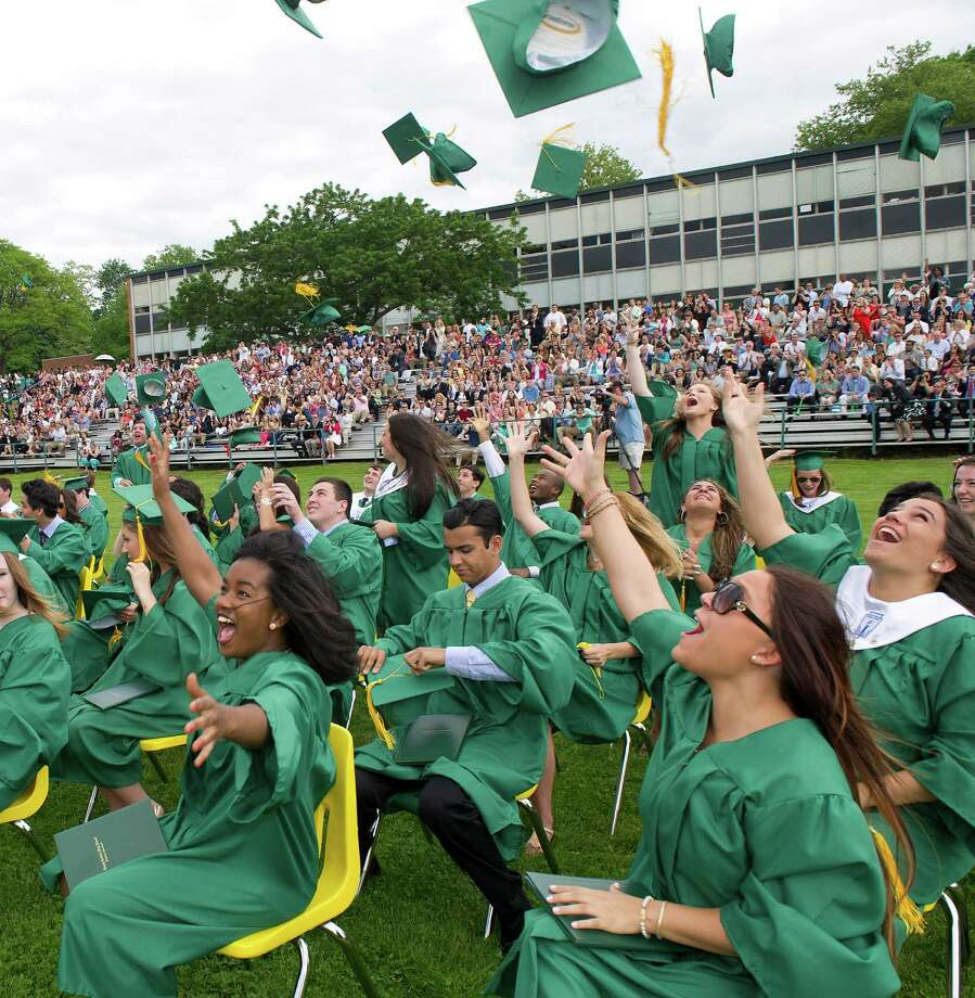 Students celebrate their graduation during Trinity Catholic's commencement ceremony on Saturday, May 31, 2014. Photo: Lindsay Perry / Stamford Advocate
