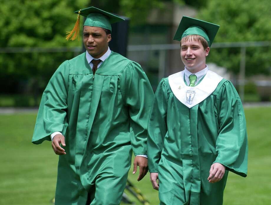 Students walk in the processional during Trinity Catholic's commencement ceremony on Saturday, May 31, 2014. Photo: Lindsay Perry / Stamford Advocate