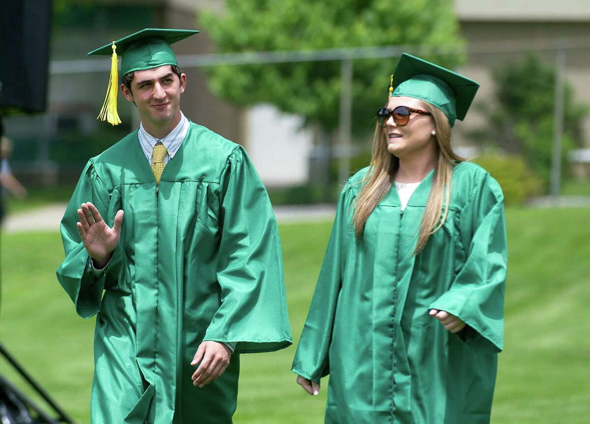 Students walk in the processional during Trinity Catholic's commencement ceremony on Saturday, May 31, 2014.