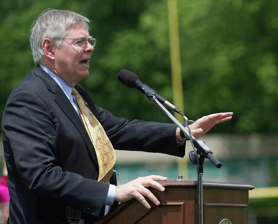 Stamford Mayor David Martin speaks during Trinity Catholic's commencement ceremony on Saturday, May 31, 2014. Photo: Lindsay Perry / Stamford Advocate
