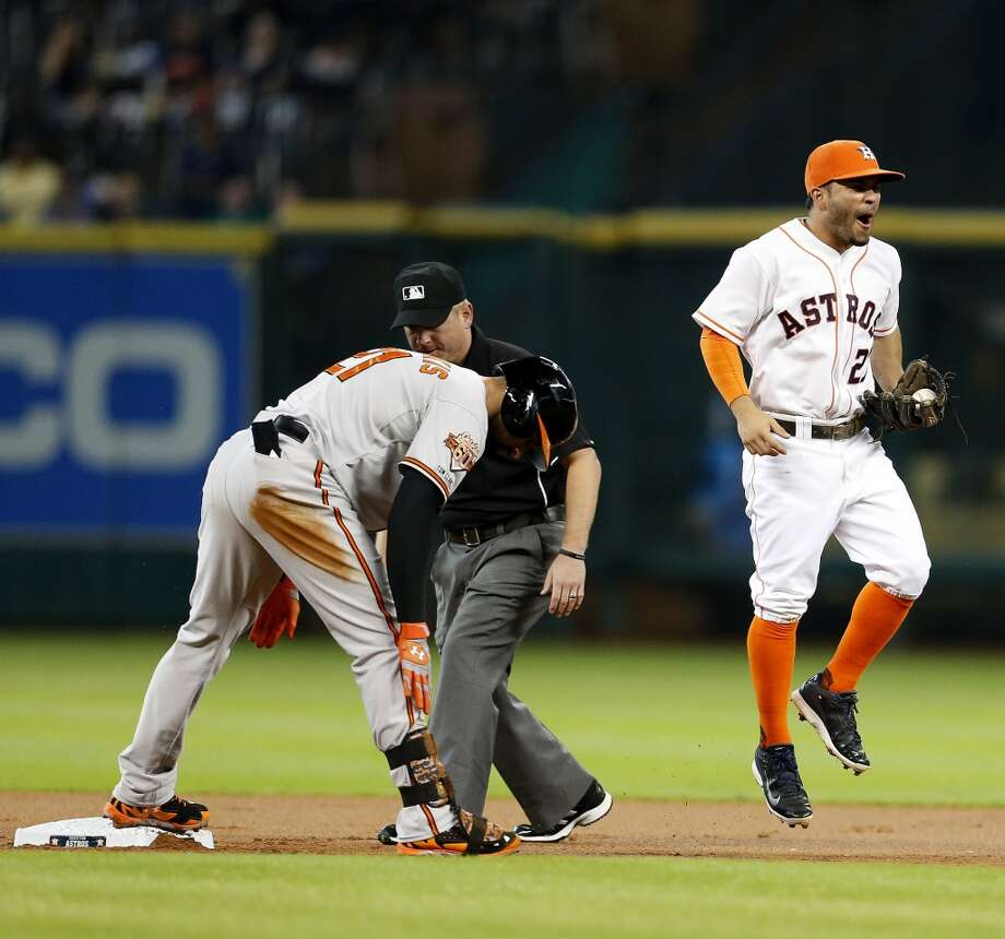 Astros second baseman Jose Altuve (27) reacts after he tried to get the tag on Baltimore Orioles right fielder Nick Markakis (21) at second after he sliding in on his double during the first inning. Photo: Karen Warren, Houston Chronicle