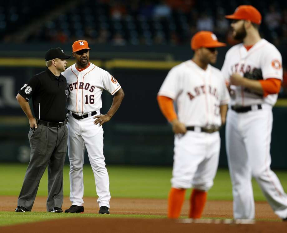 Astros manager Bo Porter (16) argues with umpire Mike Muchlinski, that Jose Altuve (27) tagged Baltimore Orioles right fielder Nick Markakis (21) at second on his double during the first inning. Photo: Karen Warren, Houston Chronicle