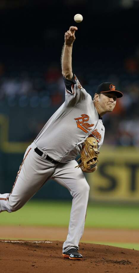 Orioles starting pitcher Chris Tillman (30) pitches during the first inning. Photo: Karen Warren, Houston Chronicle