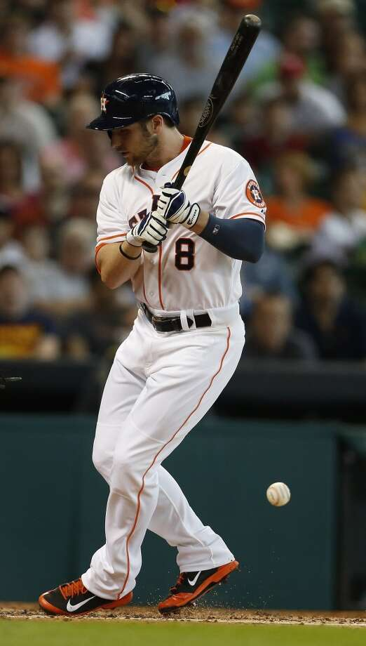 Astros left fielder Alex Presley (8) is hit by a pitch during the second inning. Photo: Karen Warren, Houston Chronicle