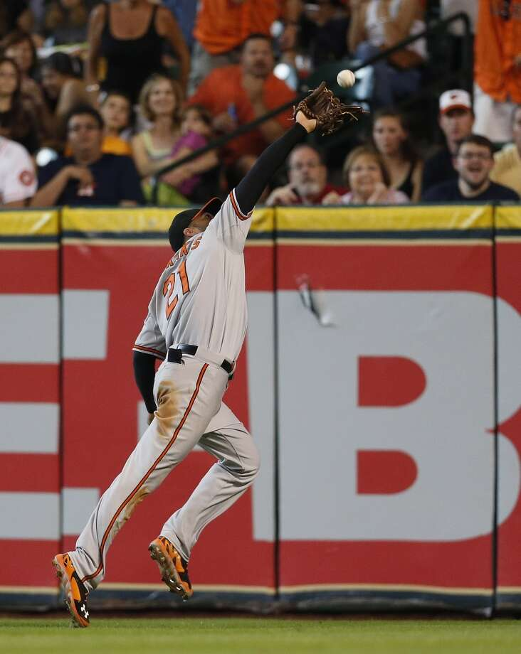 Orioles right fielder Nick Markakis (21) catches a fly out by Houston Astros second baseman Jose Altuve (27) during the second inning Photo: Karen Warren, Houston Chronicle