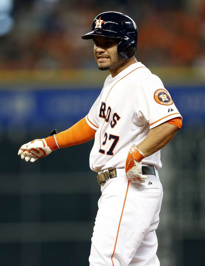 Astros second baseman Jose Altuve (27) reacts after flying out to Baltimore Orioles right fielder Nick Markakis (21) during the second inning. Photo: Karen Warren, Houston Chronicle