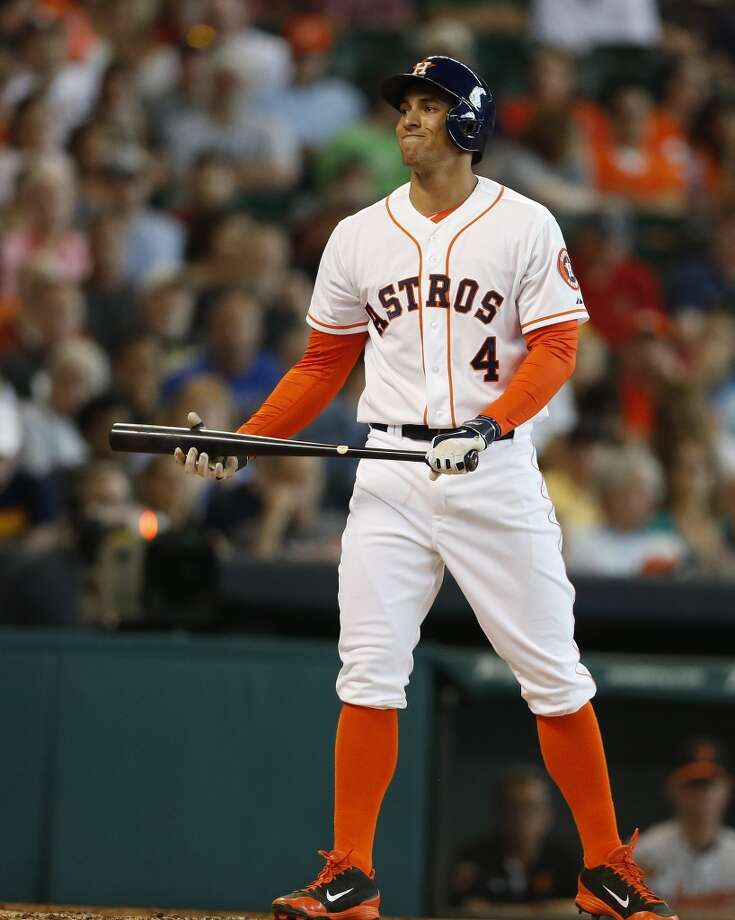 Astros right fielder George Springer (4) reacts after striking out during the third inning. Photo: Karen Warren, Houston Chronicle