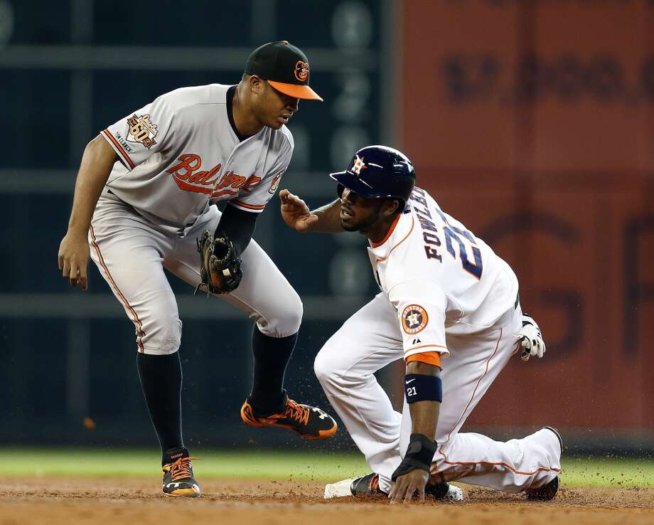 Astros center fielder Dexter Fowler (21) is safe at second on a wild pitch as Baltimore Orioles second baseman Jonathan Schoop (6) tries to tag him during the third inning. Photo: Karen Warren, Houston Chronicle