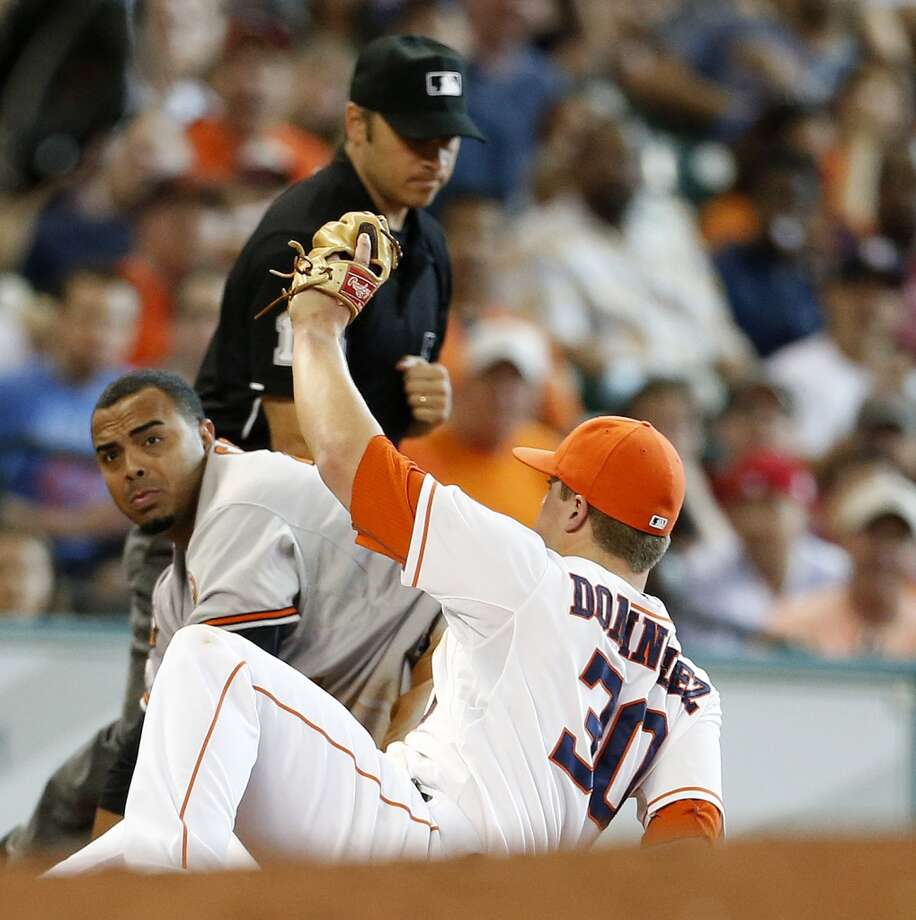 Orioles left fielder Nelson Cruz (23) is caught stealing third base by Houston Astros third baseman Matt Dominguez (30) during the fourth inning. Photo: Karen Warren, Houston Chronicle