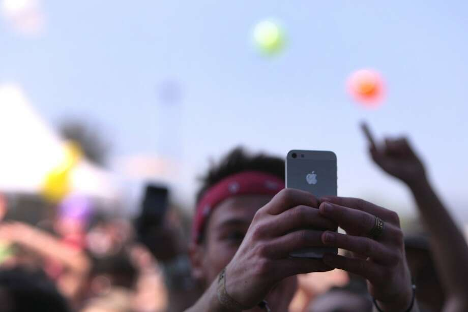 A fan takes a selfie during Matt and Kim's performance at the 2014 Bottlerock Napa Valley music, food and wine festival on Saturday, May 31, 2014 in Napa, Calif. Photo: Kevin N. Hume, The Chronicle