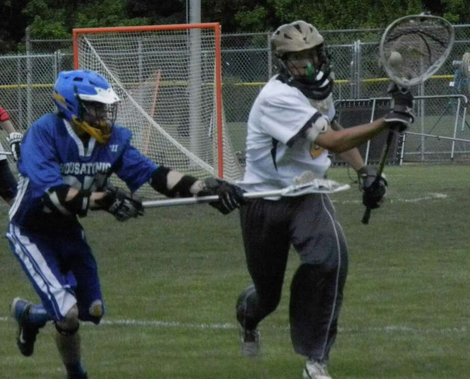 Notre Dame-Fairfield goalie Andres Rosales bringing the ball upfield against Housatonic Valley Regional on Saturday, May 31 in a CIAC Class S boys lacrosse qualifying-round game. Rosales made six saves in the Lancers' 9-7 victory. Photo: Reid L. Walmark / Fairfield Citizen