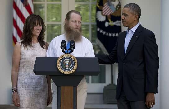 Accompanied by President Barack Obama, Jani Bergdahl and Bob Bergdahl speak during a news conference in the Rose Garden of the White House in Washington on Saturday, May 31, 2014 about the release of their son, U.S. Army Sgt. Bowe Bergdahl. Bergdahl, 28, had been held prisoner by the Taliban since June 30, 2009. He was handed over to U.S. special forces by the Taliban in exchange for the release of five Afghan detainees held by the United States. (AP Photo/Carolyn Kaster) Photo: Carolyn Kaster, Associated Press