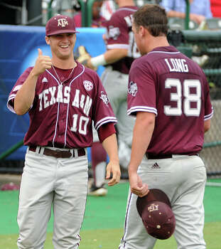 "Texas A&M pitcher Grayson Long (38) gets a ""thumbs up"" from teammate Andrew Vinson after the fourth inning of a Houston NCAA baseball regional game against George Mason, Saturday, May 31, 2014, at Reckling Park in Houston. Photo: Eric Christian Smith, For The Chronicle"