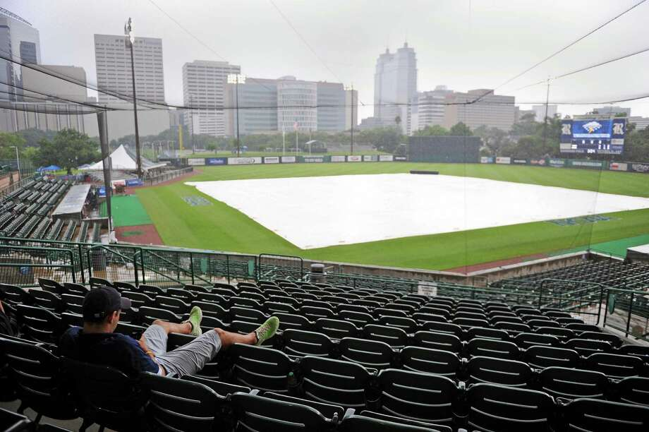 Usher Cody Moles waits out a rain delay before a Houston NCAA baseball regional game between Texas A&M and George Mason, Saturday, May 31, 2014, at Reckling Park in Houston. Photo: Eric Christian Smith, For The Chronicle
