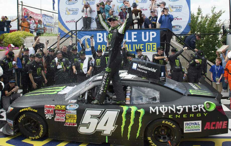 Kyle Busch hits Victory Lane for the second time in two days after winning the Nationwide Series Buckle Up 200 on Saturday. He won the truck race Friday. Photo: Molly Riley / Associated Press / FR170882 AP