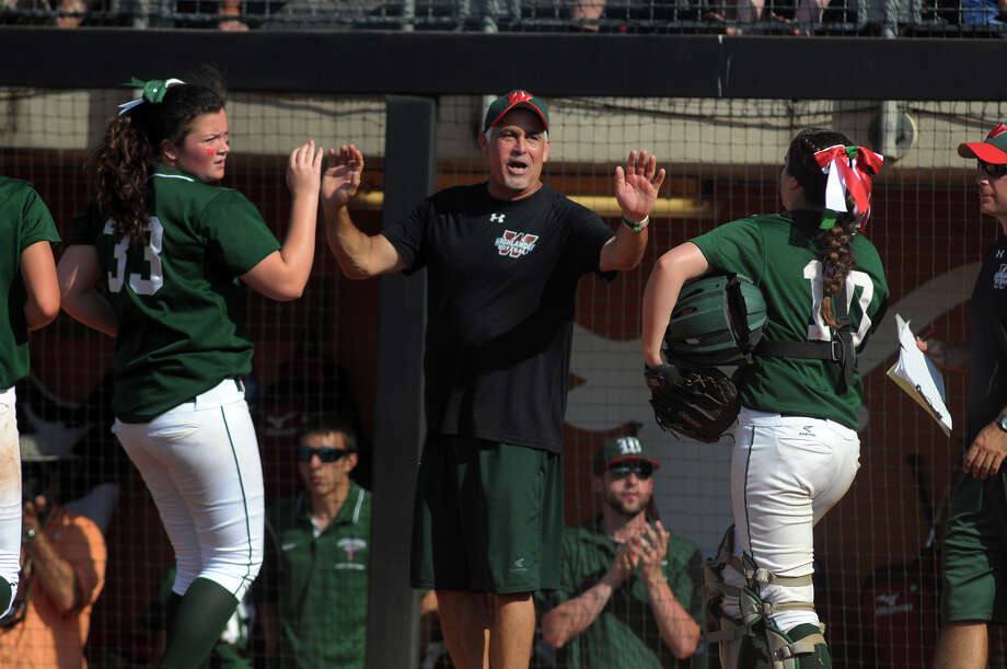 State title game:The Woodlands head coach Richard Jorgensen, center, high-fives his battery of pitcher Caitlin Bartsch, left, and catcher Kelcy Leach after retiring Deer Park in the bottom of the 4th inning of their Class 5A UIL 'State Softball Championship game at McCombs Field in Austin on Saturday. Photo: Jerry Baker, For The Chronicle