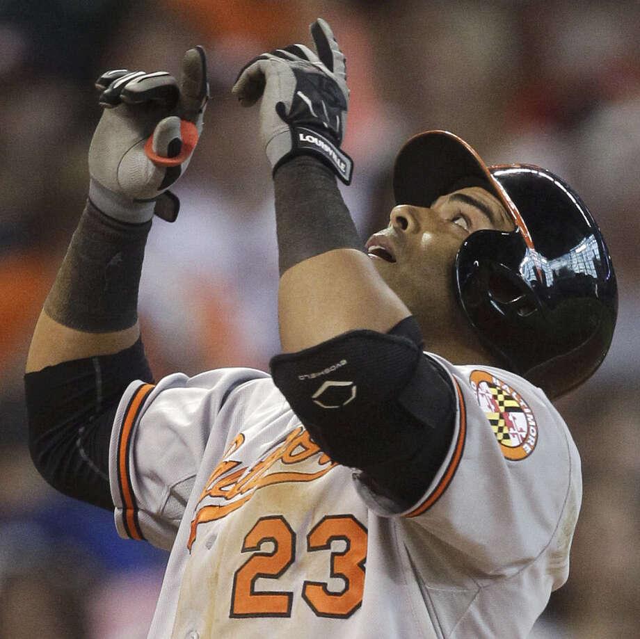 Baltimore's Nelson Cruz, celebrating his solo homer, helped put an end to Houston's season-high seven-game win streak. Photo: Patric Schneider / Associated Press / FR170473 AP