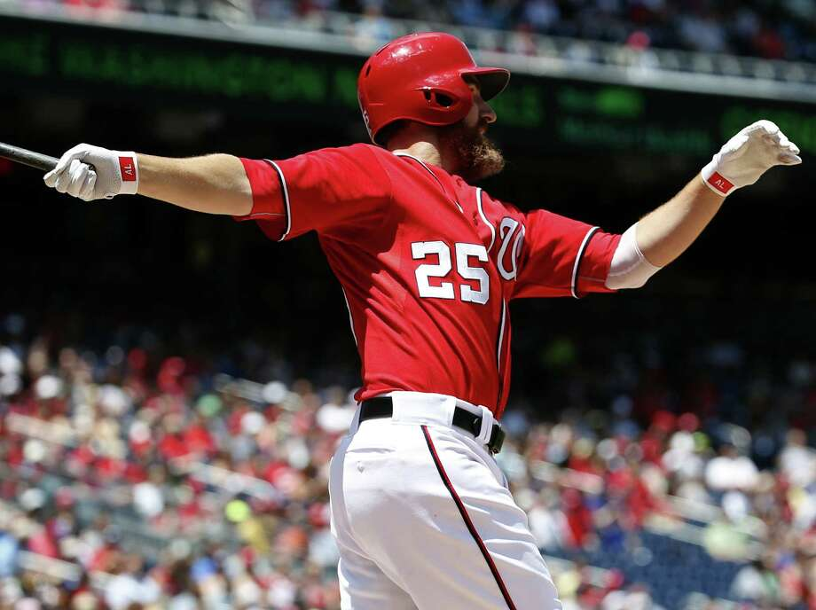 Adam LaRoche of the Nationals watches his three-run homer in the fourth inning against the Rangers in Washington. It was the seventh homer of the season for LaRoche. Anthony Rendon, Jose Lobaton and Scott Hairston also homered for the Nationals. Photo: Alex Brandon / Associated Press / AP