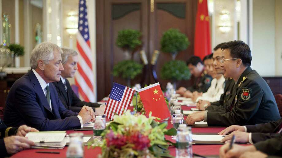 """Chuck Hagel (left) meets with Chinese Lt. Gen. Wang Guanzhong ( right), who says, """"You were very candid this morning and, to be frank, more than our expectation."""" Photo: Pablo Martinez Monsivais / Getty Images / 2014 Getty Images"""