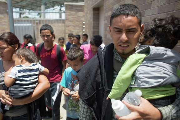 Honduran Edilberto Lanza Mejia and his family are released by Border Patrol at the McAllen bus station.