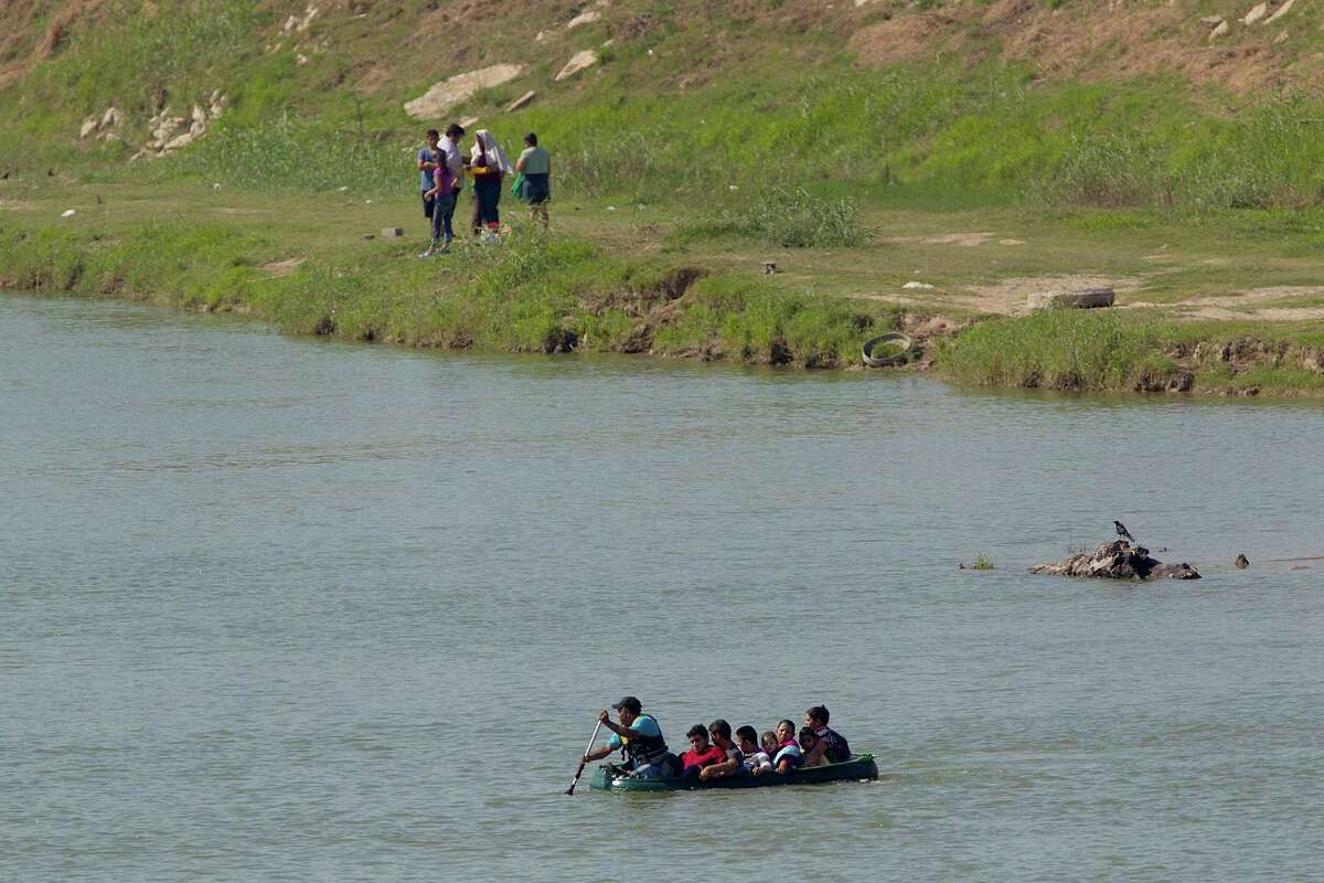A group of seven people are smuggled Saturday from Mexico across the Rio Grande to Anzalduas County Park in Mission. The group from El Salvador and Honduras is made up of a mother with a 7-year-old son, another mother with a 4-year-old daughter, an 11-year-old boy and two 17-year-olds.