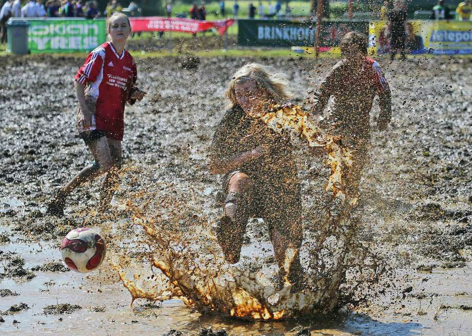 A player kicks the ball out of the mud during the German  Mud Soccer Championships in Rieste, Germany, Saturday, May 31, 2014. Some 1,000 participants from all over Germany compete in three categories, men, women and mixed for the German Championship titles. Photo: Frank Augstein, Associated Press / AP