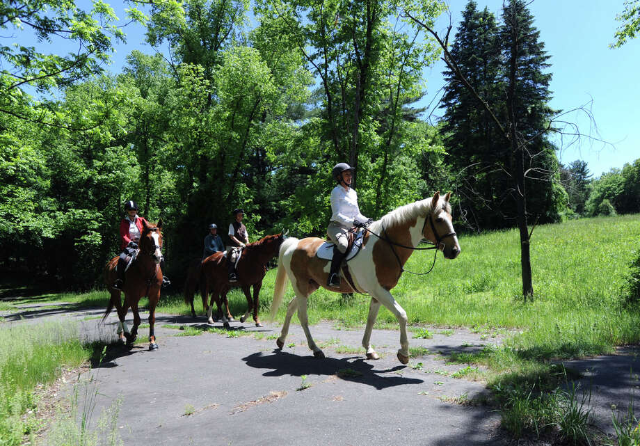 Led by rider Susan Mufson, right, of Greenwich, on her horse, Playboy, members of the Greenwich Riding and Trails Association ride at Nichols Preserve in Greenwich. The Greenwich Riding and Trails Association is celebrating its 100th anniversary. Photo: Bob Luckey / Greenwich Time